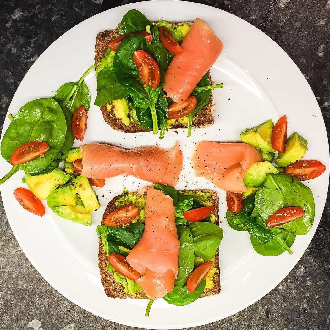 Salmon and tomato and avocado on toast